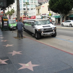 The Hummer limousine rolls up, cameras waiting...
