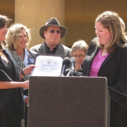 Angela Motta of Councilmember Eric Garcetti's office presents CHANGE coalition members with a Certificate of Appreciation