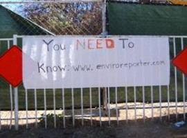 EnviroReporter sign on fence at Runkle Canyon