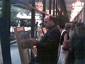 "Gala attendee inspects ""Rocketdyne Ranch"" expose on display in main hall."