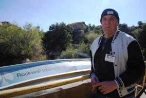 Lewis MacAdams next to Rocketdyne boat-WPB