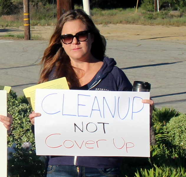 Cleanup not coverup protest sign